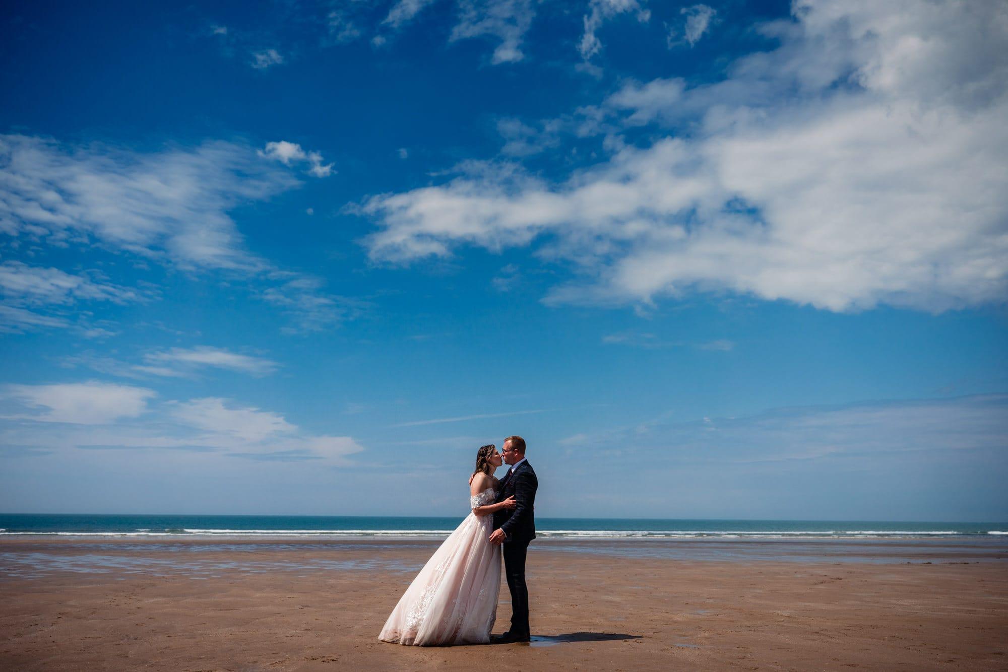 Wedding couple on sandy beach