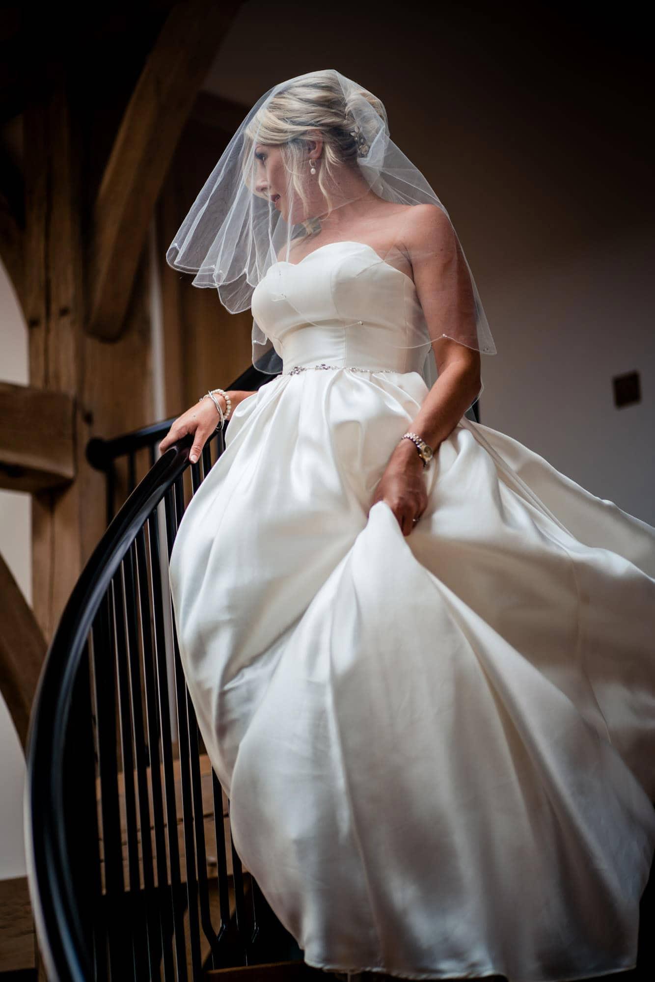 bride on spiral staircase Somerset wedding photographer