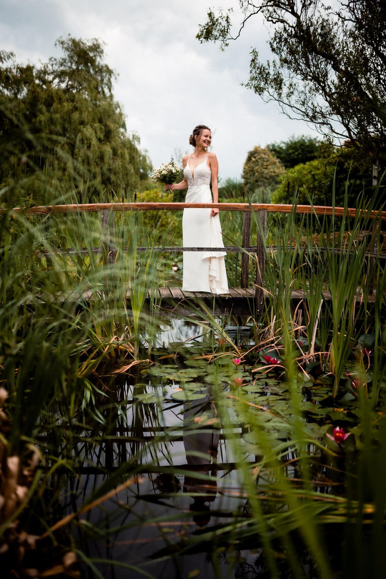 dorset wedding photography bride on bridge