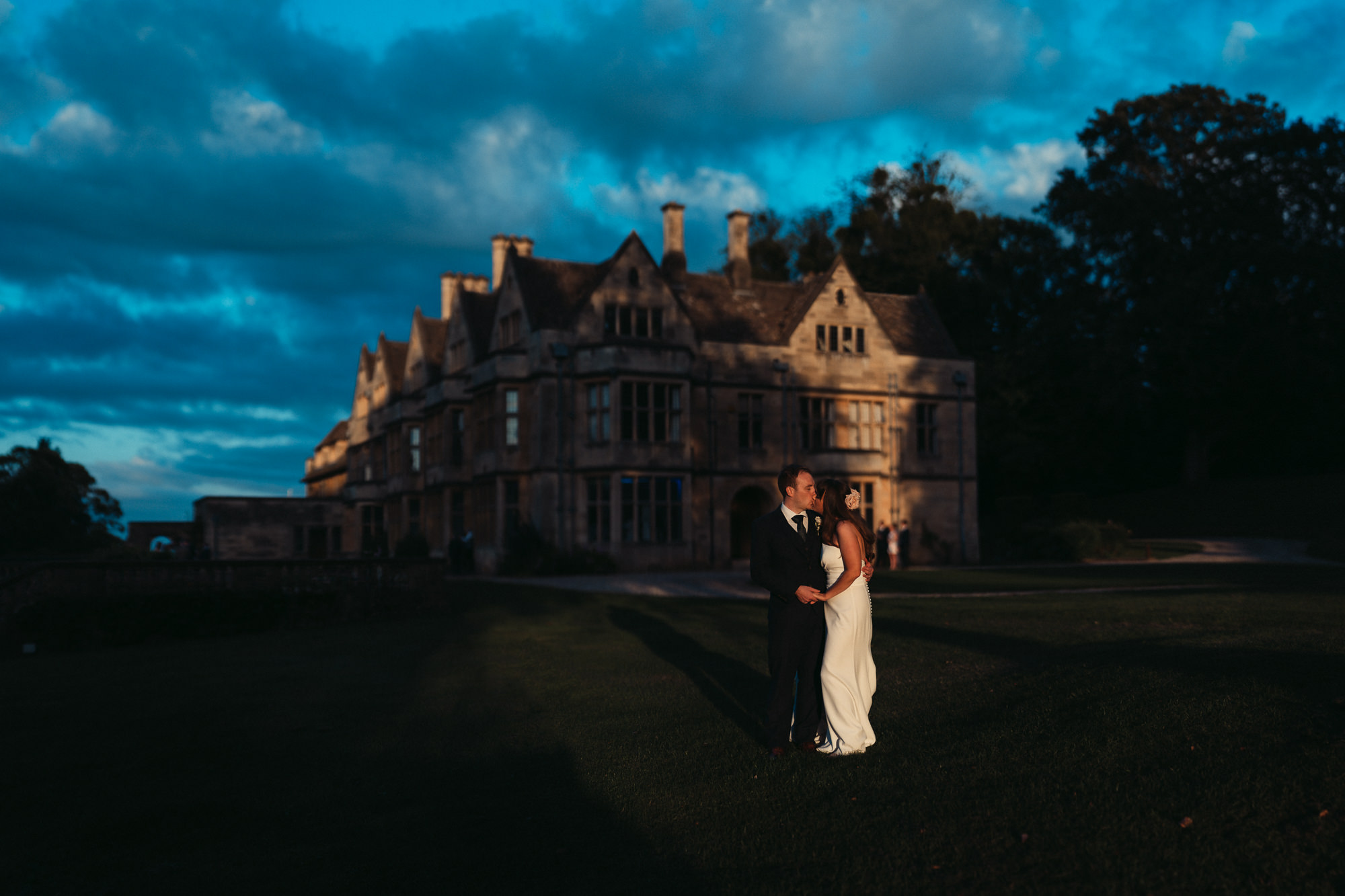 bride and groom outside coombe lodge