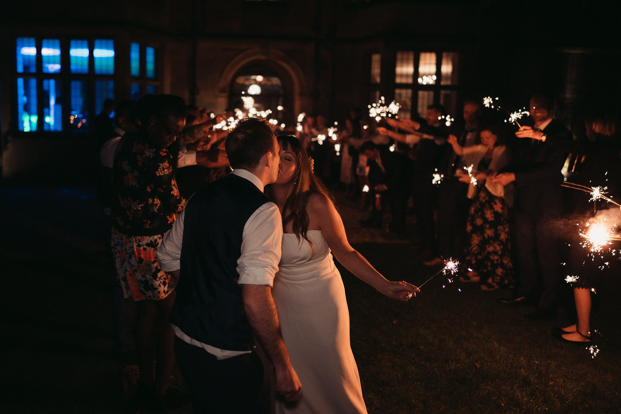 newlyweds sparkler exit at coombe lodge