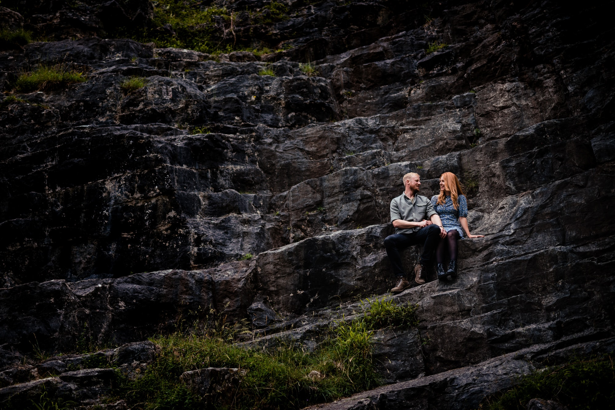 Devon enngagement photography couple sitting in cheddar gorge