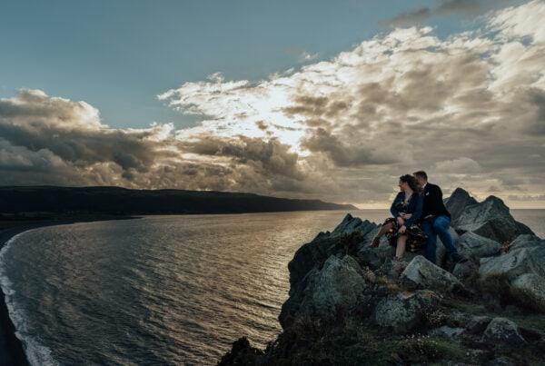 couple sat on cliff in devon