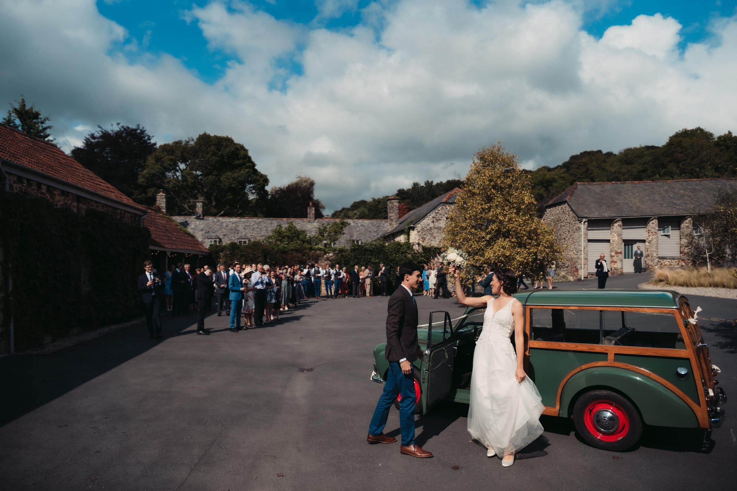bride and groom getting out of Morris minor