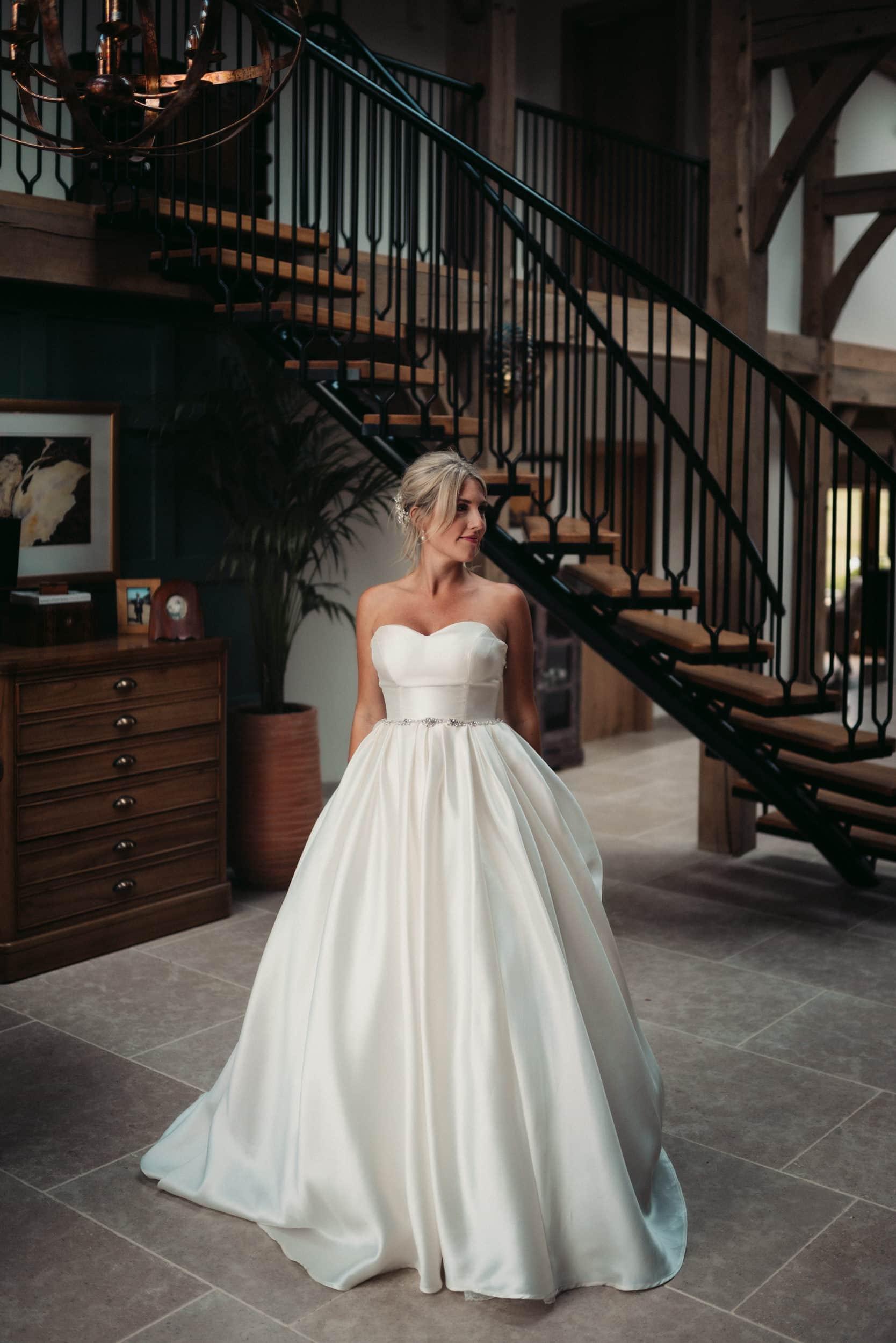 pregnant bride stood in atrium