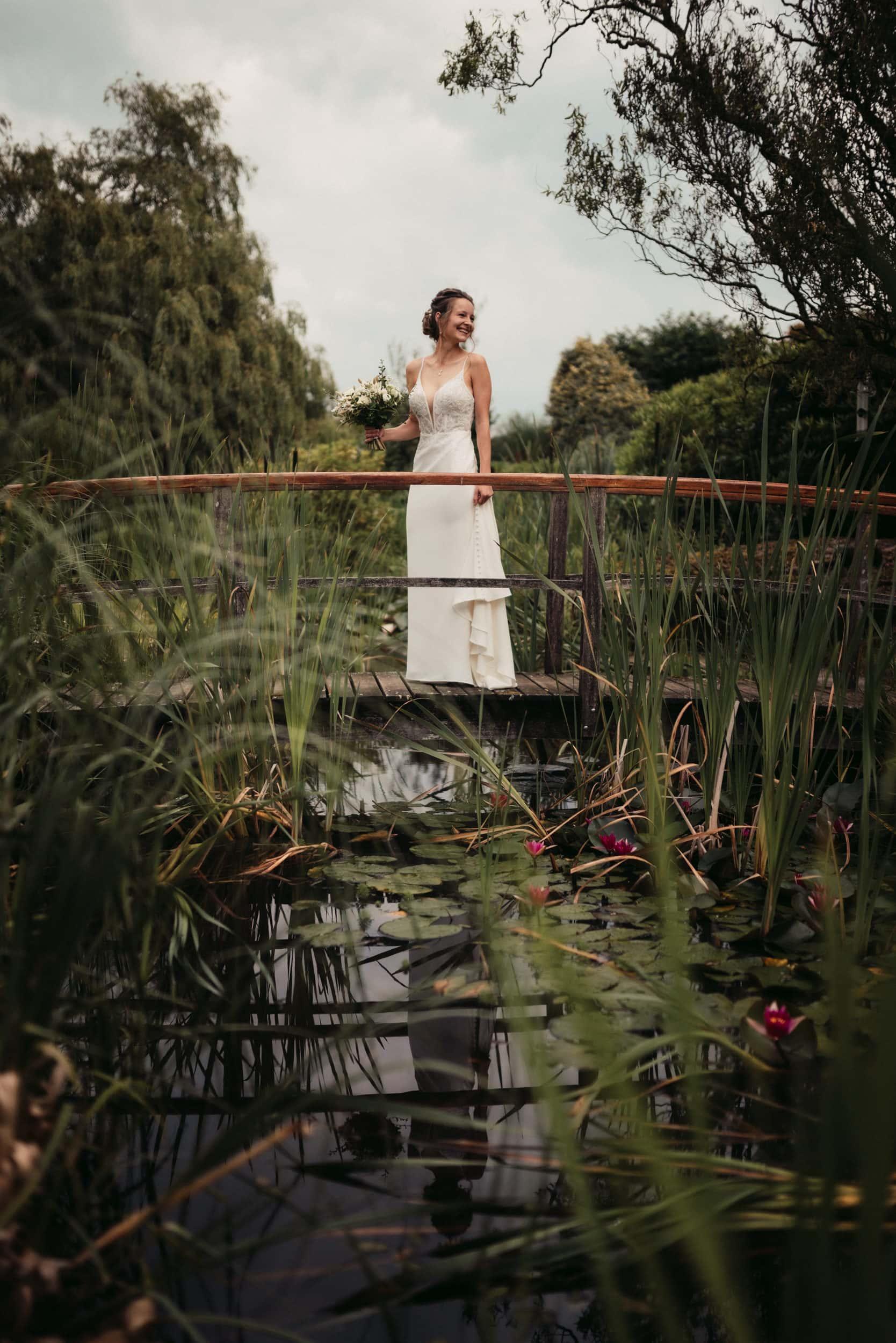 bride stood on bridge before her wedding