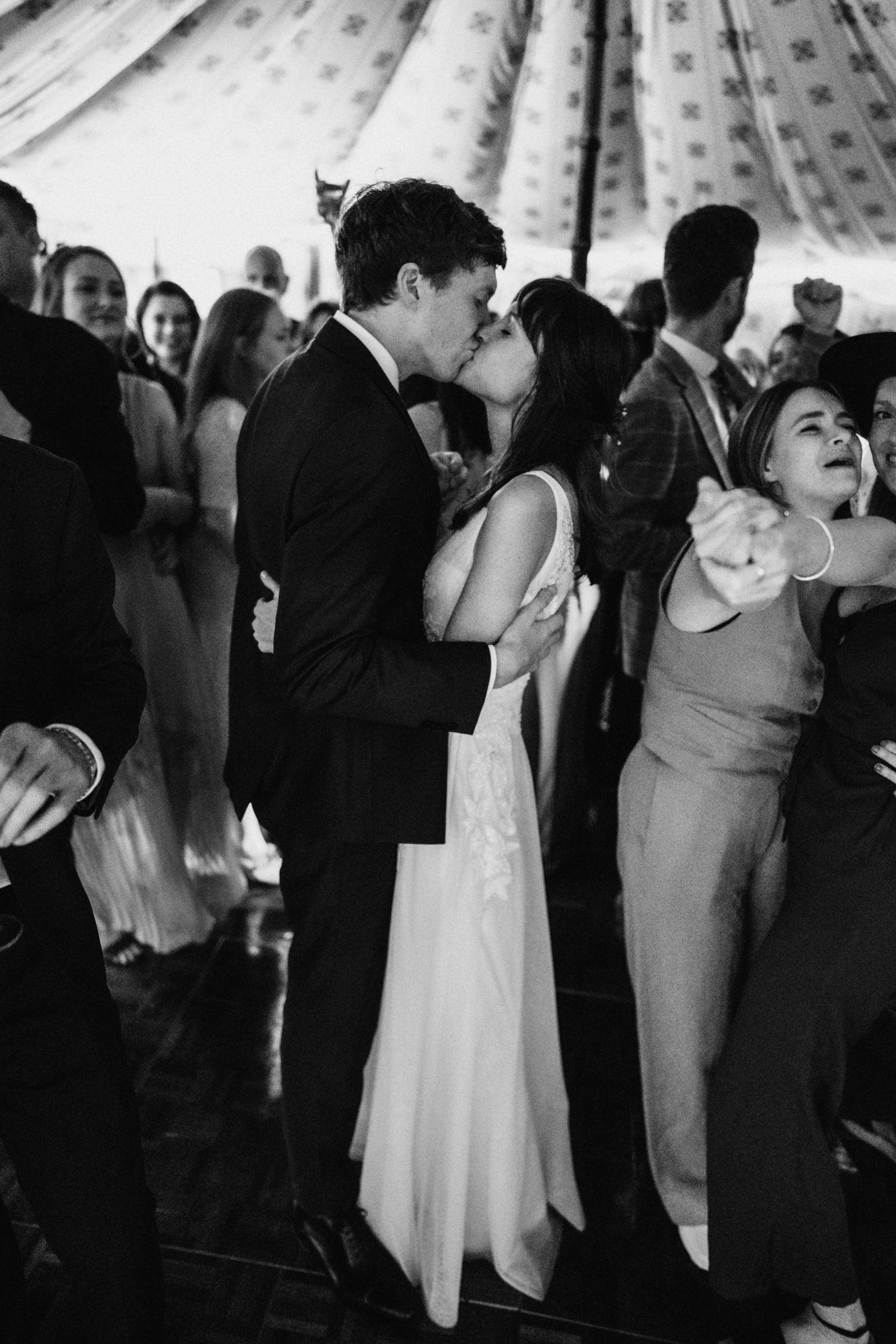 new married couple kiss on the dancefloor
