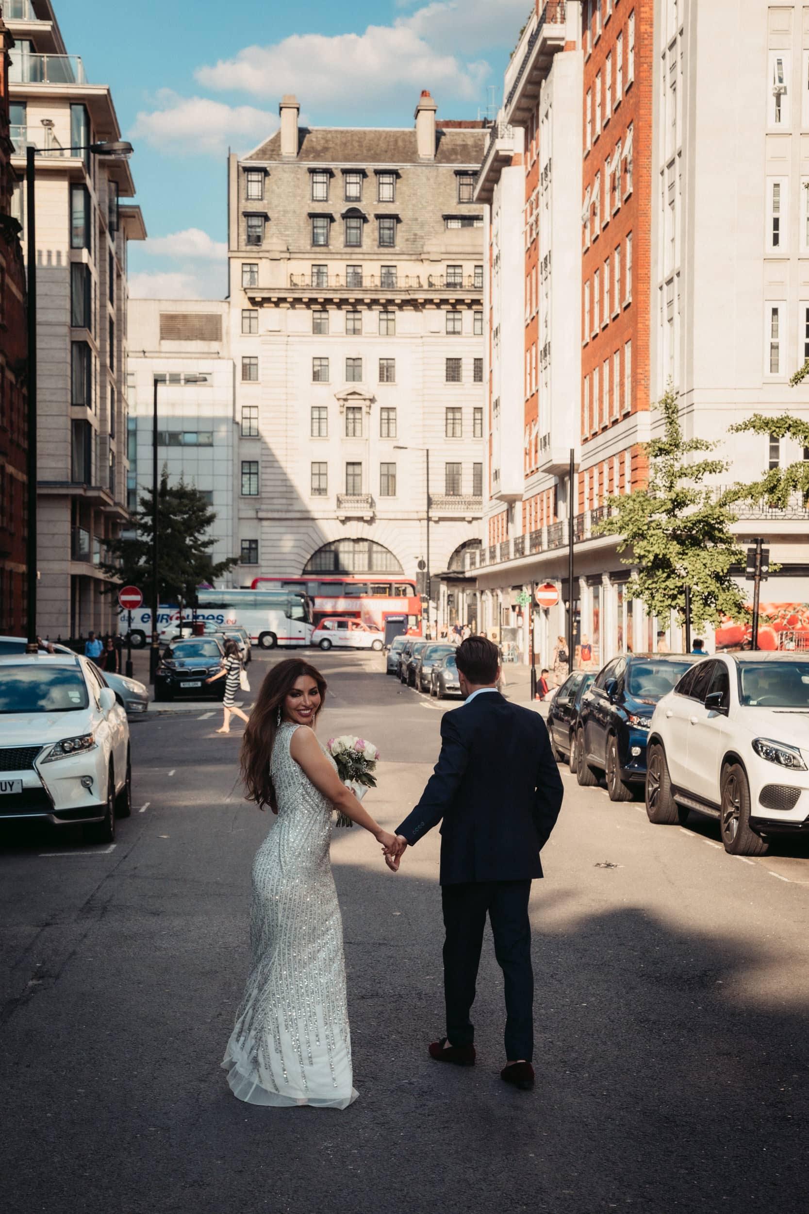 wedding couple walking down street in Marylebone London