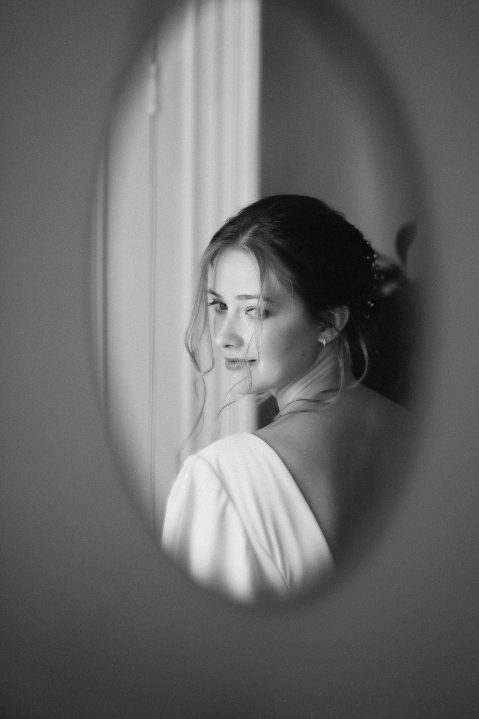bride in oval mirror black and white portrait