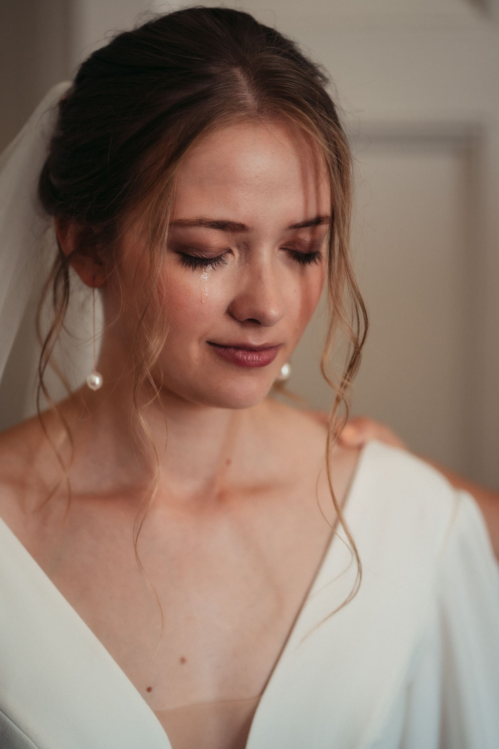 bride tear rolling down her face