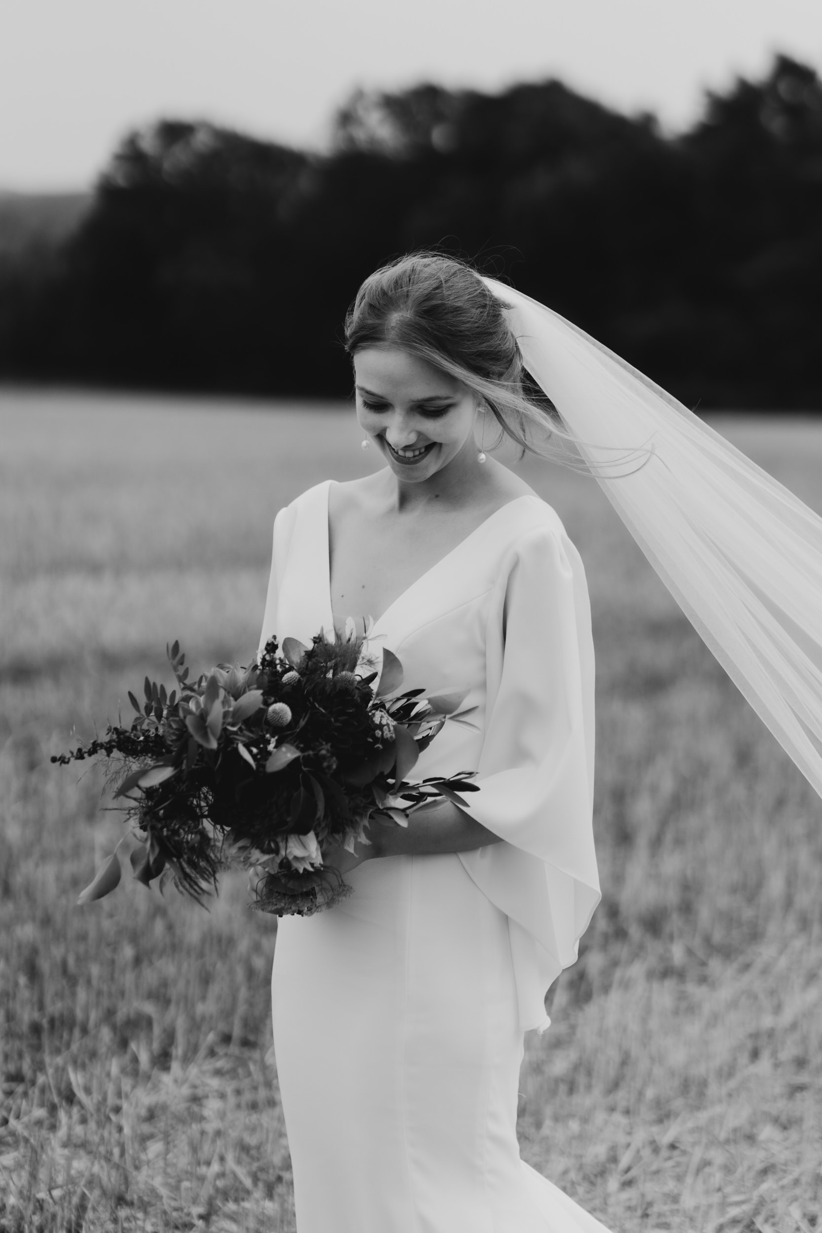 bride with veil blowing in wind at rye hill barn
