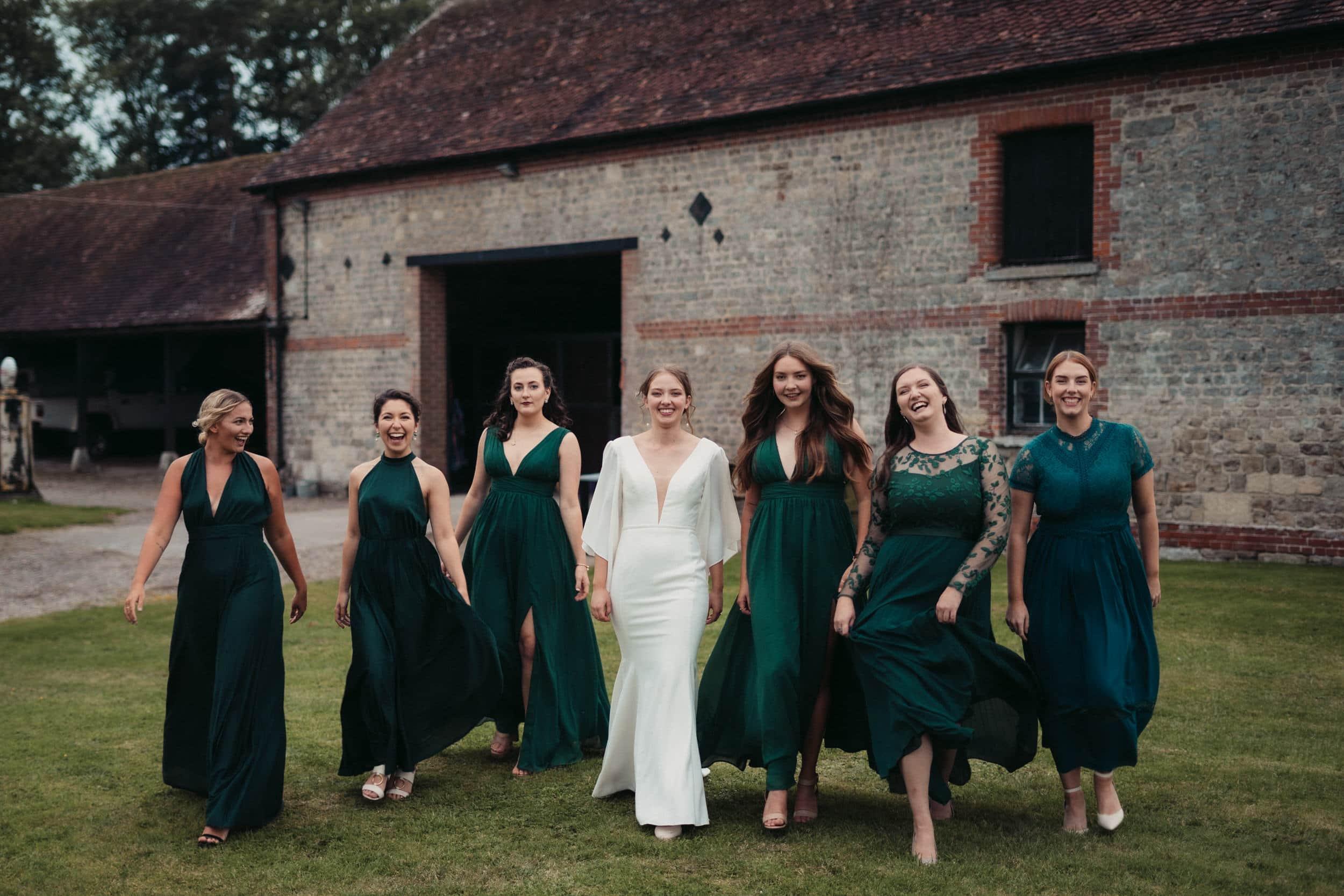 bride and bridesmaids model walking at rye hill barn